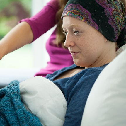 Woman with cancer reading book