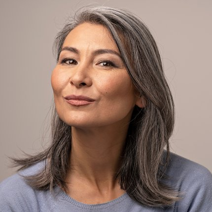 thoughtful asian woman with gray hair