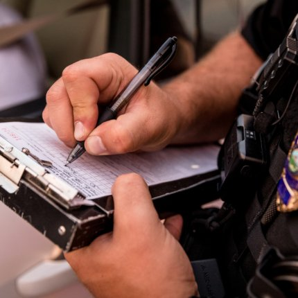 Police officer writing a ticket.