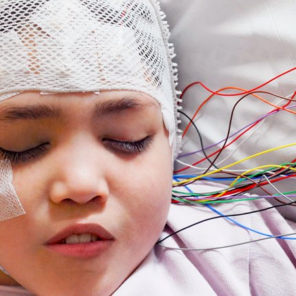 Girl hooked up to electrodes