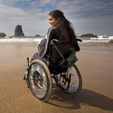 woman on beach in wheelchair