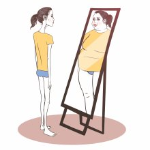 Girl looking in mirror at distorted self