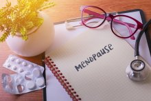 Stethoscope on note book with Menopause words as medical concept