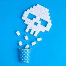 Sugar cubes in the shape of a skull on a bright blue background.