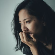Depressed asian woman