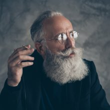 elderly man smoking a joint
