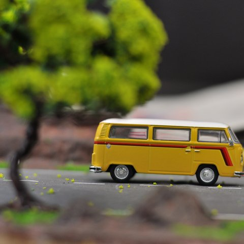 Toy VW bus on street