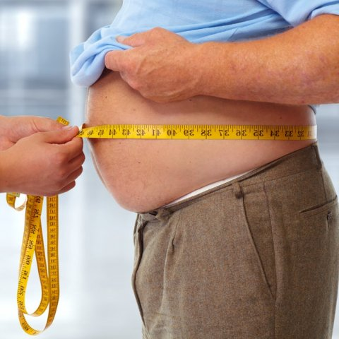 Image of doctor measuring BMI