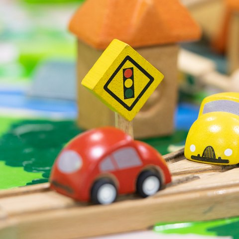 Toy cars on a brio set