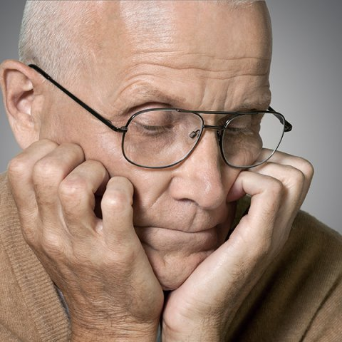 pensive man with glasses