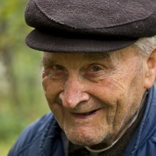 Smiling senior citizen with fisherman hat