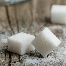 sugar cubes on wooden table