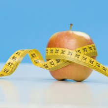 Apple with measuring tape