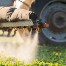 Pesticides being sprayed on crops