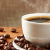Cup of coffees and loose coffee beans