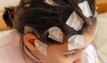 child with electrodes on head, awake